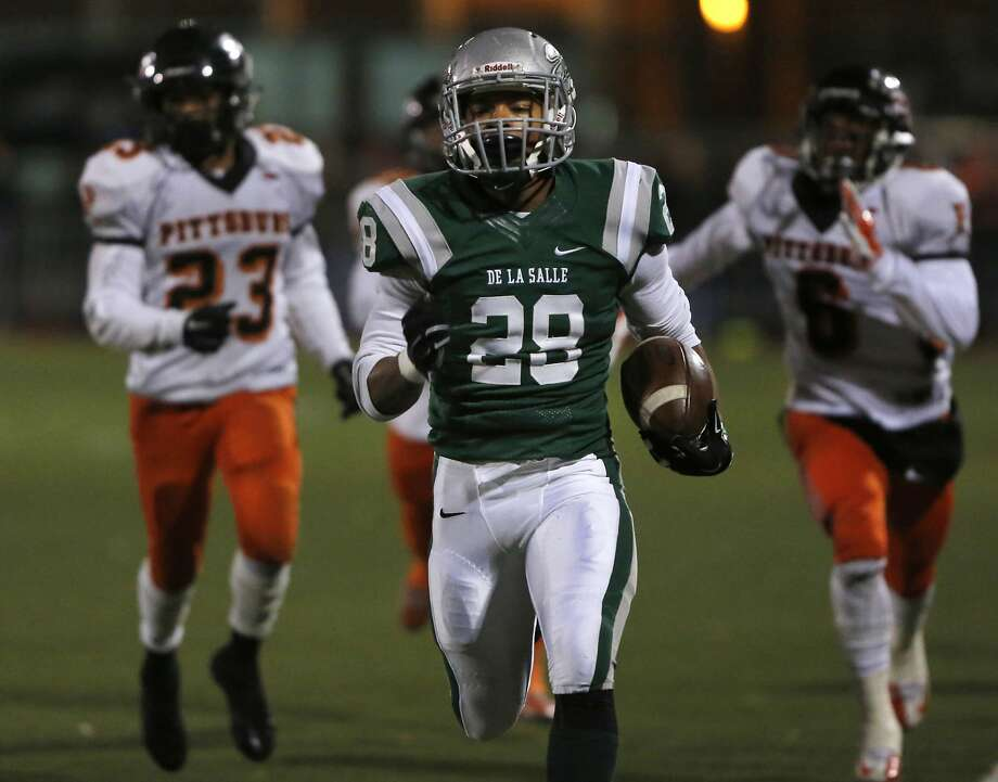 Antoine Custer of De La Salle runs the ball down the field for a touchdown during the Division I North Coast Section playoff game of Pittsburg High School vs. De La Salle High School at De La Salle High School Nov. 27, 2015 in Concord, Calif. Photo: Leah Millis, The Chronicle