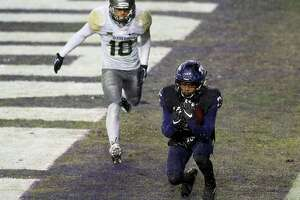TCU washes away Baylor's playoff hopes with rainy, overtime win - Photo