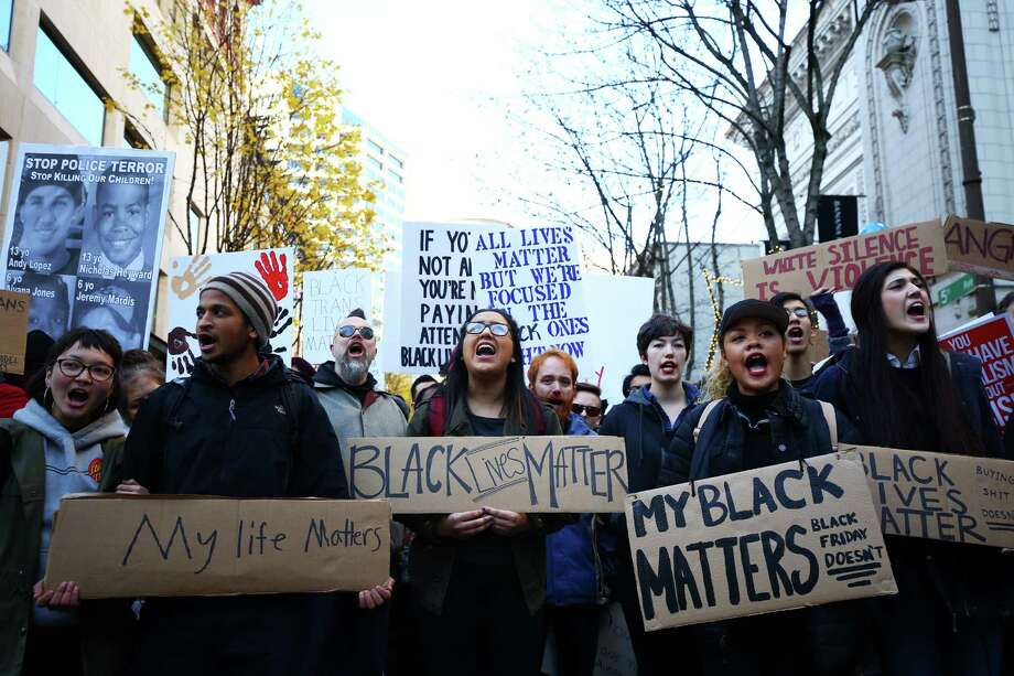 Black Lives Matters protesters marched through downtown Seattle, including through Westlake Center and Pacific Place mall, Friday, to bring attention to police brutality, civil rights issues, consumerism, Nov. 27, 2015.  The march ended at Westlake Park to disrupt the annual tree-lighting ceremony. Photo: GENNA MARTIN, SEATTLEPI.COM / SEATTLEPI.COM