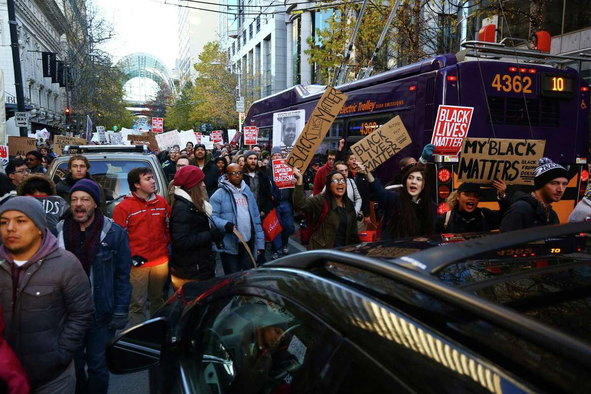 Black Lives Matters protesters marched through downtown Seattle, including through Westlake Center and Pacific Place mall, Friday, to bring attention to police brutality, civil rights issues, consumerism, Nov. 27, 2015. The march ended at Westlake Park to disrupt the annual tree-lighting ceremony.