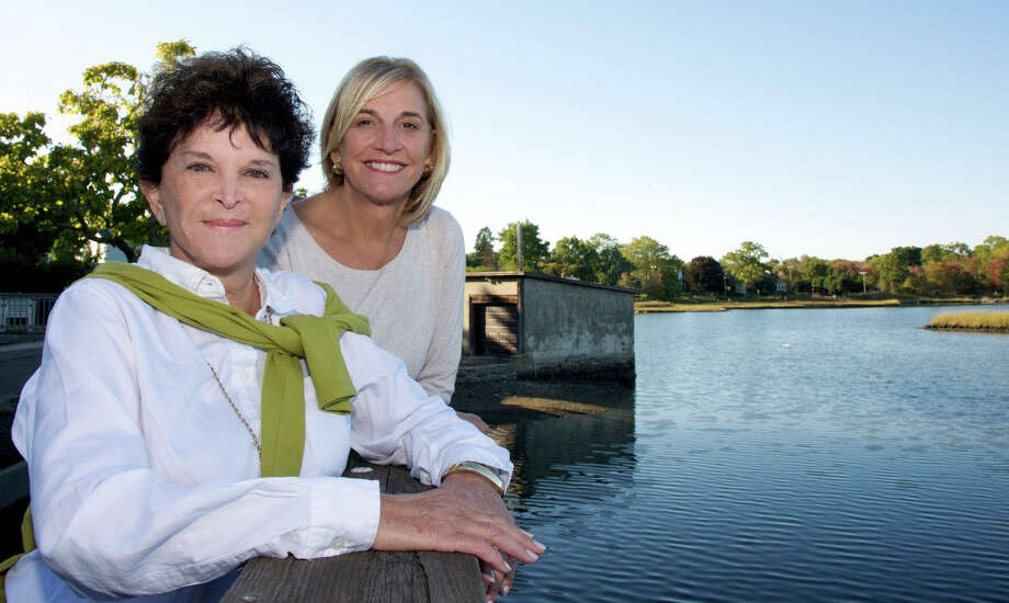 """Judy Katz, author of the new book, """"The beautiful POND,"""" about Old Mill Pond, with friend and supporter Robin Tauck at the pond. Photo: Contributed Photo / Westport News"""