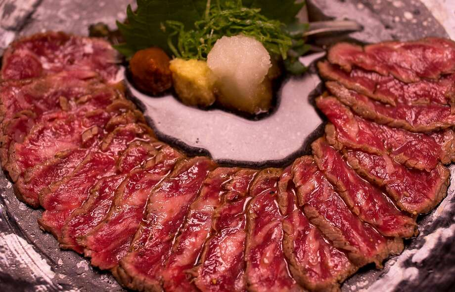 Wagyu beef tataki ($22) at Village Sake offers thin slices of marbled beef. Photo: John Storey, Special To The Chronicle