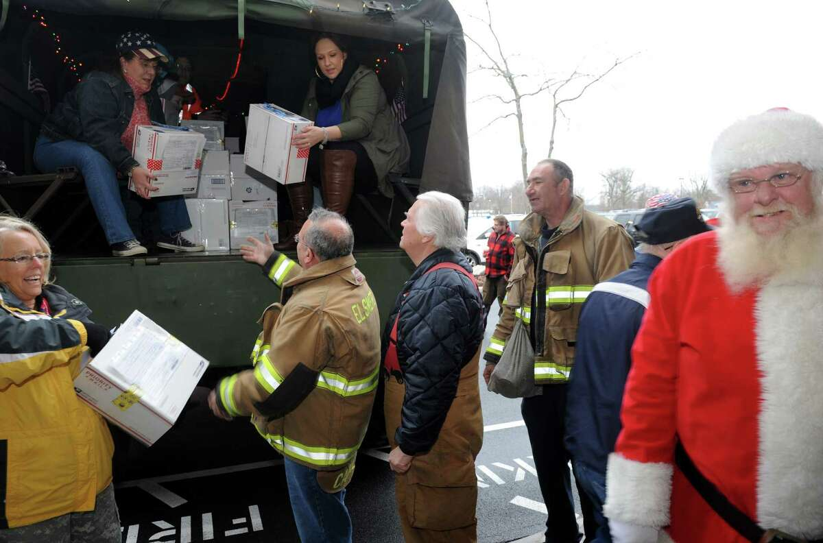 Melody Burns, left, coordinate the Christmas Cards to our Troops 2015 on Saturday Nov. 28, 2015 in Glenmont, N.Y. Last year they sent 120,000 from Glenmont NY to all Deployed troops around the world. (Michael P. Farrell/Times Union)