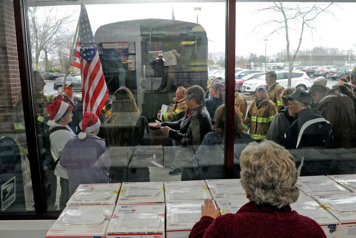 Volunteers unload boxes of cards at the Glenmont post office for the Christmas Cards to our Troops 2015 on Saturday Nov. 28, 2015 in Glenmont, N.Y. Last year they sent 120,000 from Glenmont NY to all Deployed troops around the world. (Michael P. Farrell/Times Union)