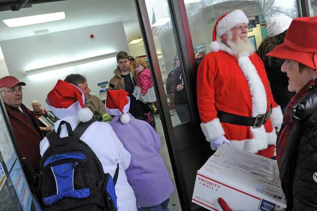 Volunteers unload boxes of cards at the Glenmont post office for the Christmas Cards to our Troops 2015 on Saturday Nov. 28, 2015 in Glenmont, N.Y. Last year they sent 120,000 from Glenmont NY to all Deployed troops around the world. (Michael P. Farrell/Times Union) Photo: Michael P. Farrell / 00033959A