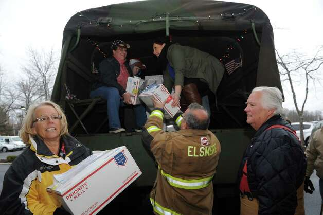 Melody Burns, left, coordinate the Christmas Cards to our Troops 2015 on Saturday Nov. 28, 2015 in Glenmont, N.Y. Last year they sent 120,000 from Glenmont NY to all Deployed troops around the world. (Michael P. Farrell/Times Union) Photo: Michael P. Farrell / 00033959A