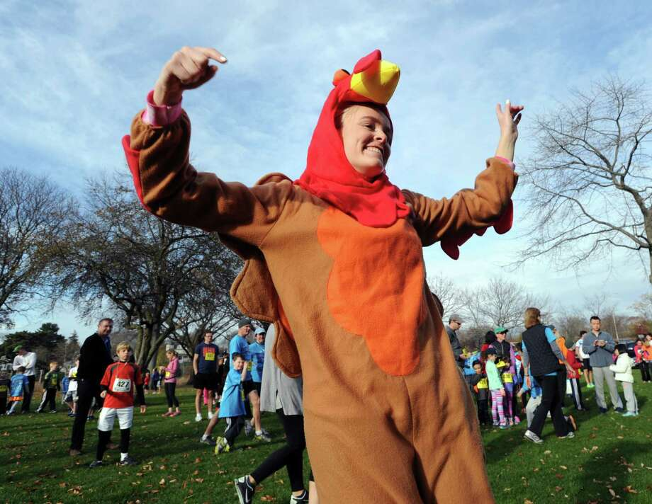 Kara Bittman, 15, of Greenwich, wore a turkey outfit to the Greenwich Alliance for Education's 5th annual Turkey Trot starting at the Arch Street Teen Center in Greenwich, Conn., Saturday morning, Nov. 28, 2015. All proceeds from the race go to foster the Alliance's educational success programs for the Greenwich Public Schools. Photo: Bob Luckey Jr., Hearst Connecticut Media / Greenwich Time