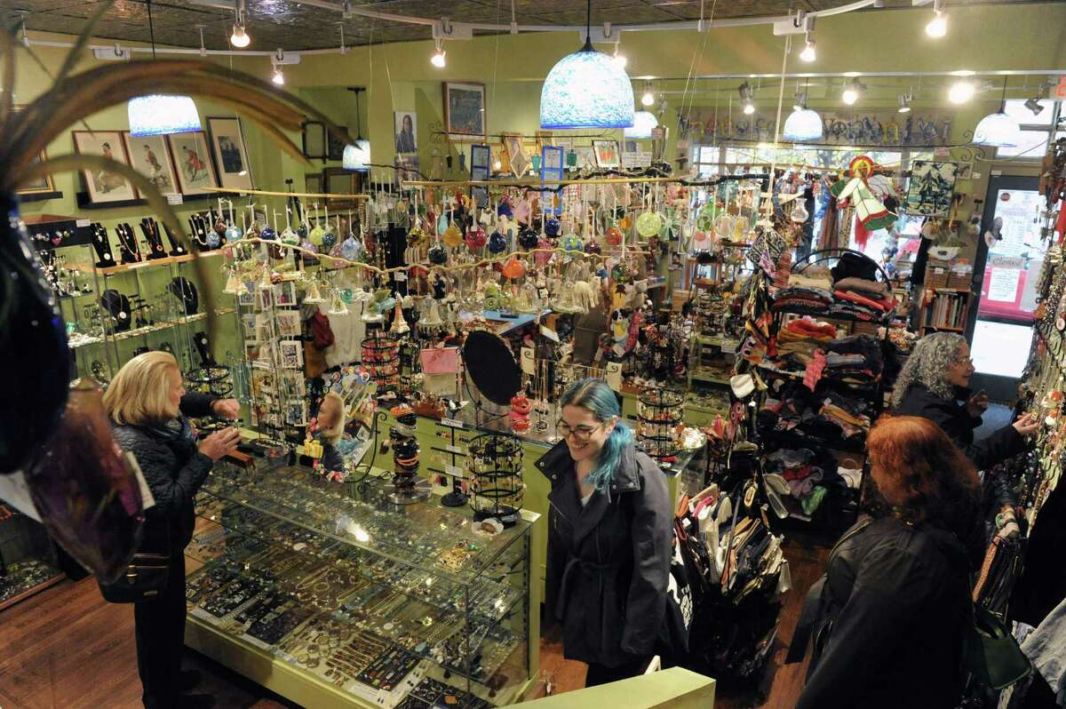 Shoppers look over the creative offerings at the Lark Street shop of Elissa Halloran Designs on Saturday Nov. 28, 2015 in Albany, N.Y. (Michael P. Farrell/Times Union)