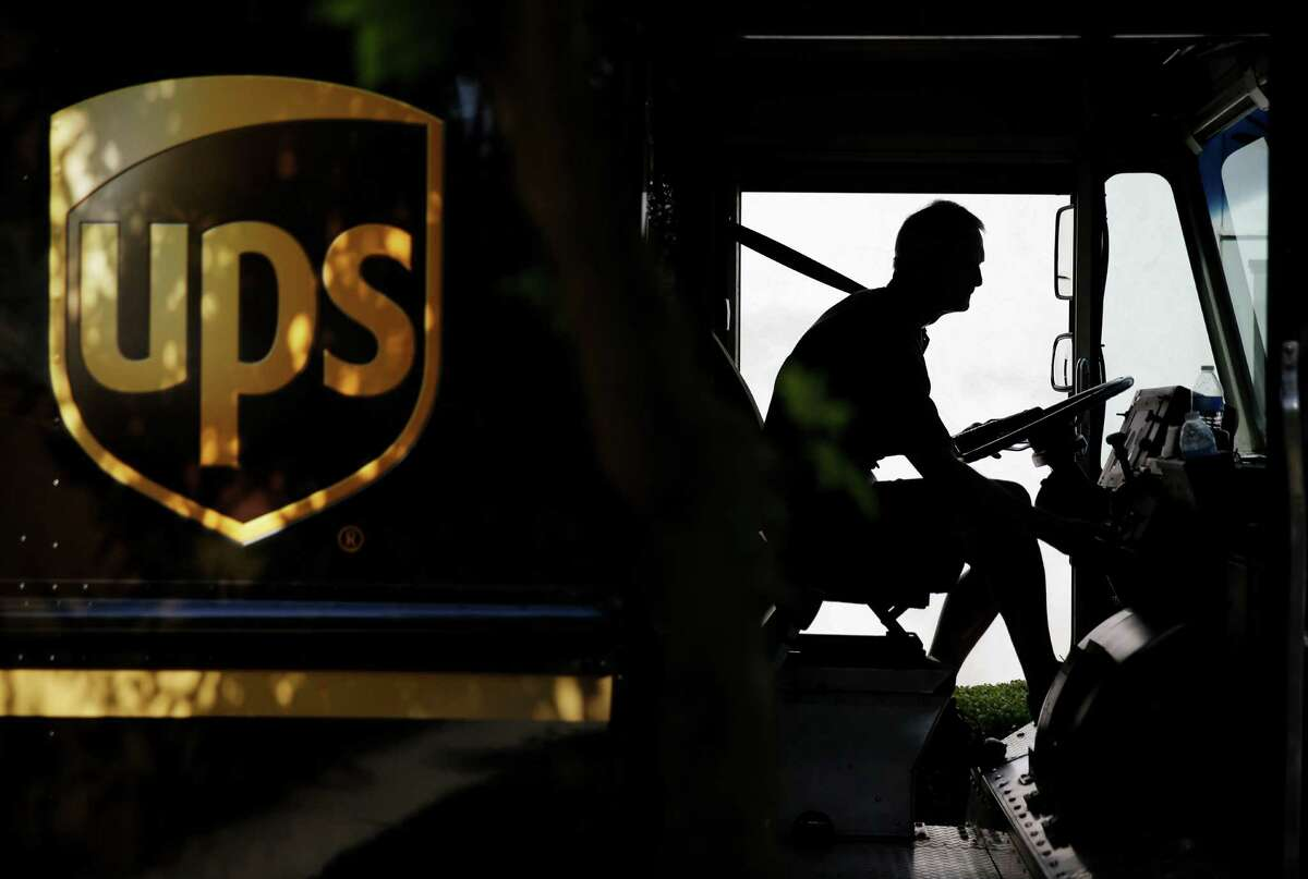 FILE - In this June 20, 2014 file photo, United Parcel Service driver Marty Thompson starts his truck up after making a delivery in Cumming, Ga. (AP Photo/David Goldman, File)