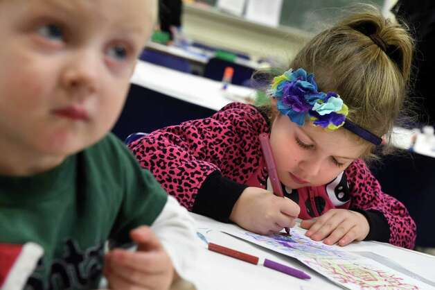 Harry Sullivan, 2, of Albany and his sister Sydney Sullivan, 4, make holiday cards during Home for the Holidays free admission weekend on Saturday, Nov. 28, 2015, at Albany Institute of History and Art in Albany, N.Y. The event continues on Sunday from noon to 4:30 p.m. (Cindy Schultz / Times Union) Photo: Cindy Schultz / 10034425A