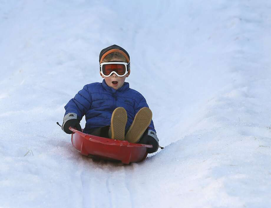 Sawyer Butler, 5, takes a ride down the Winter Wonderland holiday snow sledding hill in San Rafael, Calif. on Saturday, Nov. 28, 2015. Photo: Paul Chinn, The Chronicle