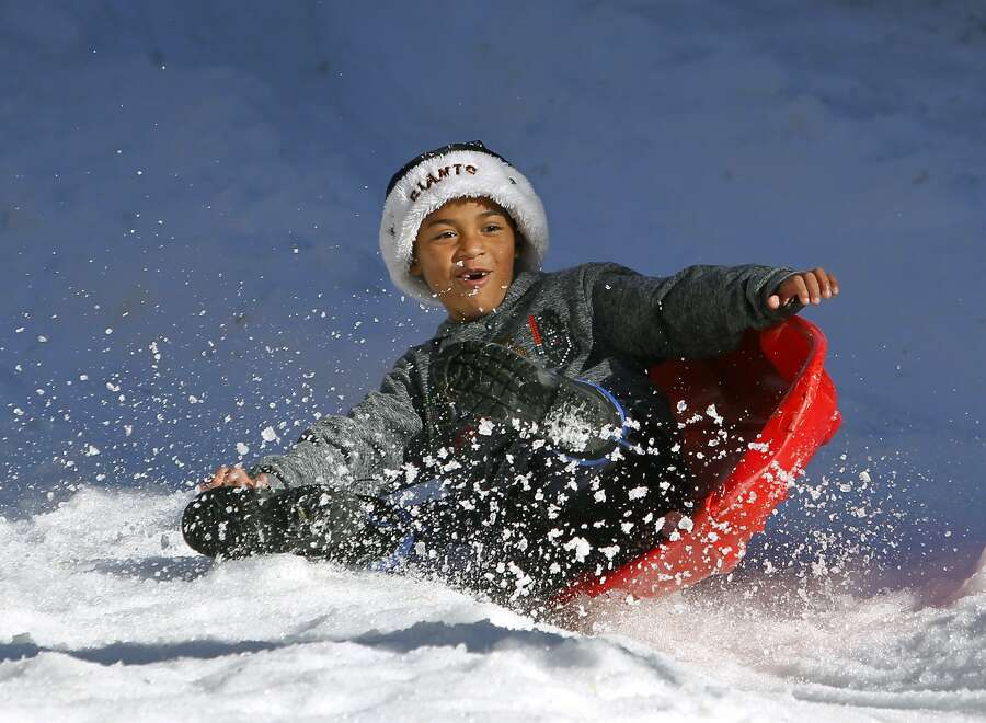 Sebastian Morales, 7, catches some air during a bumpy run down the snow sledding hill at the Winter Wonderland event in San Rafael, Calif. on Saturday, Nov. 28, 2015. Photo: Paul Chinn, The Chronicle