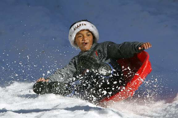 Sebastian Morales, 7, catches some air during a bumpy run down the snow sledding hill at the Winter Wonderland event in San Rafael, Calif. on Saturday, Nov. 28, 2015.