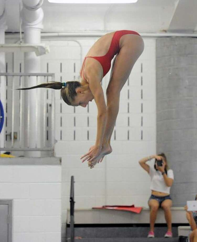 Kate Russack was one of Greenwich High School's top divers this season. Russack placed third at the Class LL championships and was fifth at the State Open competition. Photo: Bob Luckey Jr. / Greenwich Time