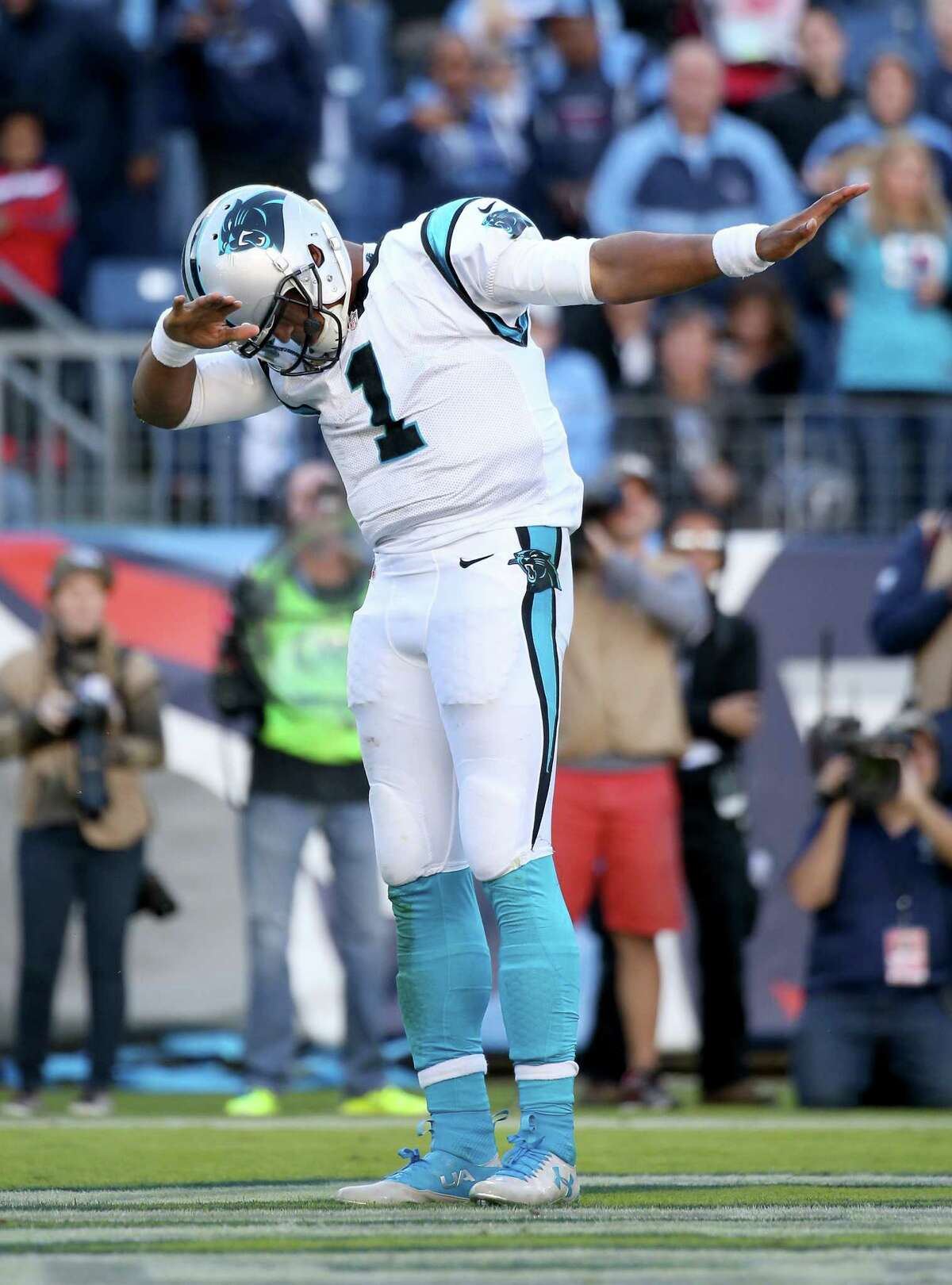 NASHVILLE, TN - NOVEMBER 15: Cam Newton #1 of the Carolina Panthers celebrates after scoring a touchdown during the second half against the Tennessee Titans at LP Field on November 15, 2015 in Nashville, Tennessee.
