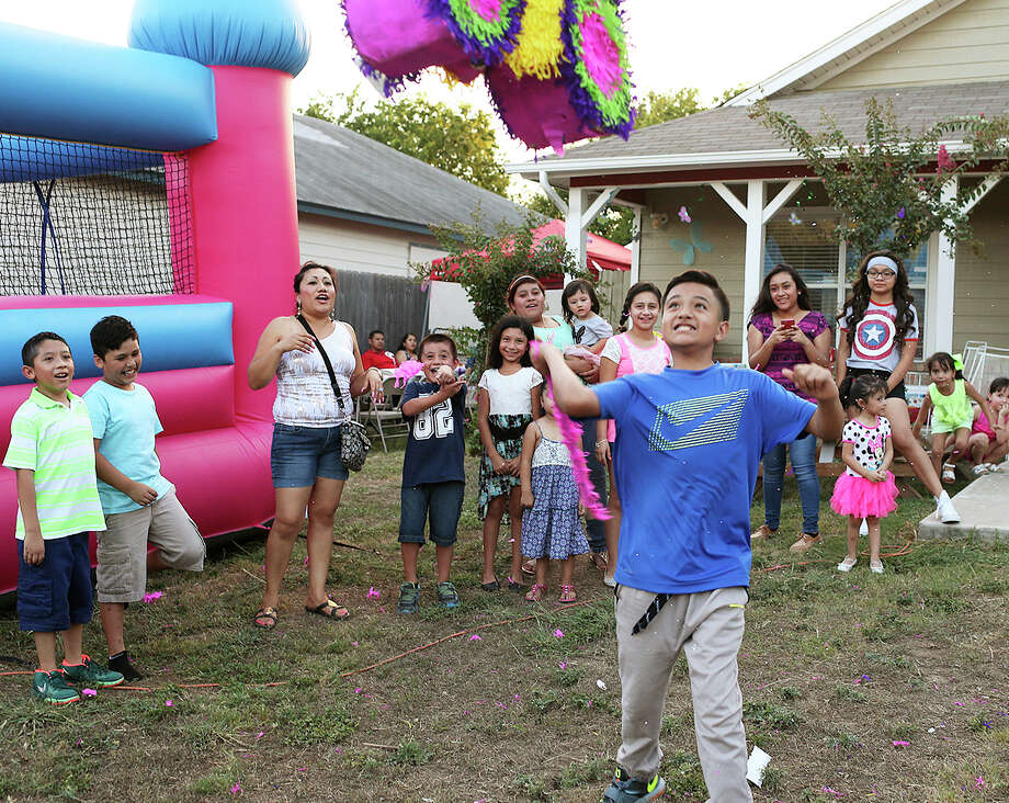 manuel gonzalez 12 takes his shots at a piata during a birthday party hosted