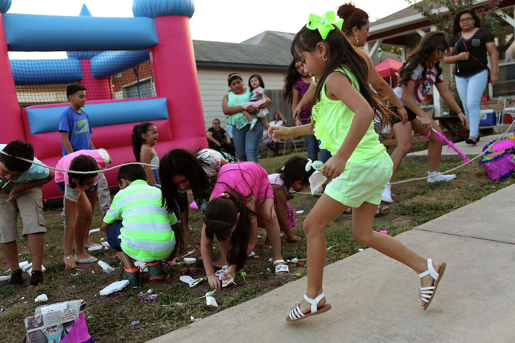 children enjoy a birthday party hosted by the torres family for their 8 year