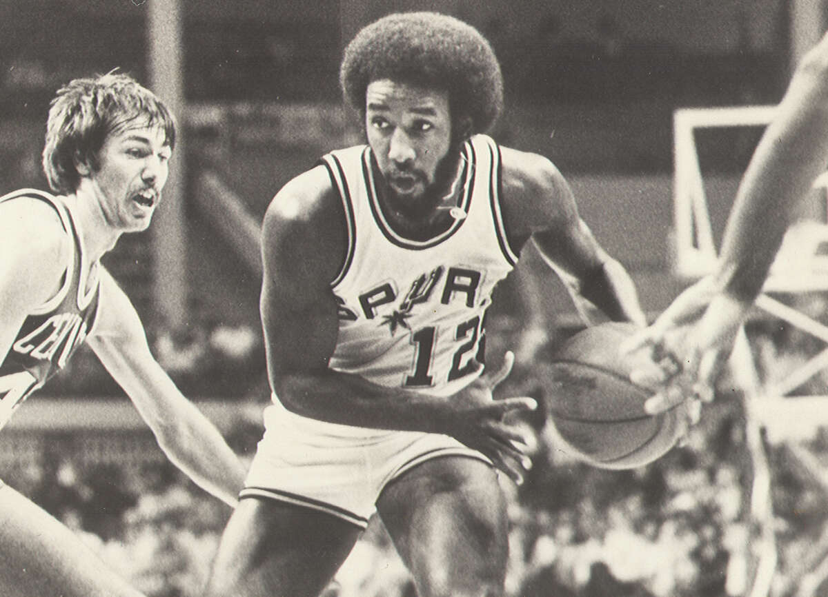 Spurs guard Mike Gale drives to the basket against the Boston Celtics at San Antonio's HemiFair Arena in 1981.