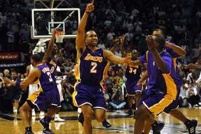 Lakers guard Derek Fisher celebrates with teammates after he hit the game-winning shot as time expired to beat the Spurs in Game 5 of the Western Conference semifinals on May 13, 2004.