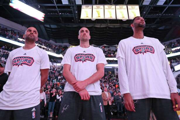 San Antonio Spurs' Tony Parker (from left), Manu Ginobili, and Tim Duncan stand during the national anthem before the game with the Charlotte Hornets  Saturday Nov. 7, 2015 at the AT&T Center.