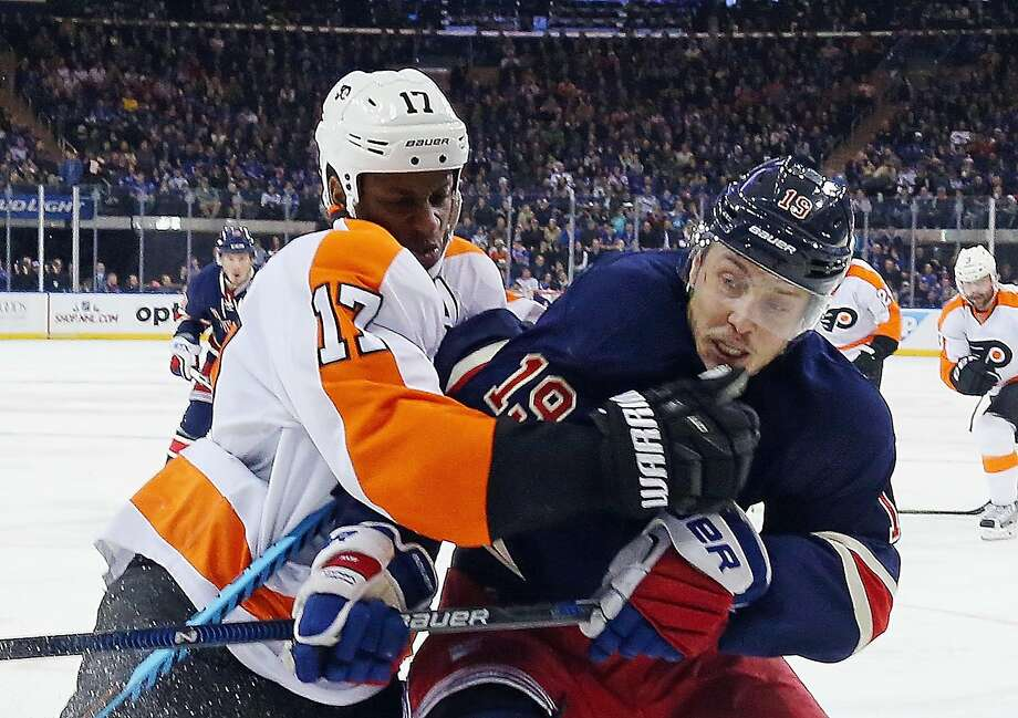 Wayne Simmonds of the Philadelphia Flyers checks Jesper Fast of the New York Rangers at Madison Square Garden. Simmonds had two goals and an assist. Photo: Bruce Bennett, Getty Images