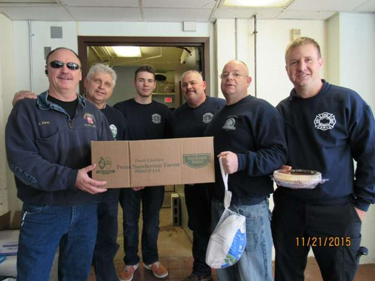 Albany firefighters joined volunteers from St. John?s/St. Ann?s Outreach Center in delivering Thanksgiving food to over 80 households in Albany?s South End on Nov. 21. Above are Bill King, Ed Wrobel, Patrick Powers, Bob Powers, Mike Schepisi, and Josh Kapczynski. Each household received a turkey, pie and other items needed for a traditional dinner. The center serves households in Albany?s South End with a food pantry, a soup kitchen, a clothing and furniture program and counseling and referrals. Volunteers not pictured include Terry Cahill, Greg Sokaris, Ed Verhoff and other family members.