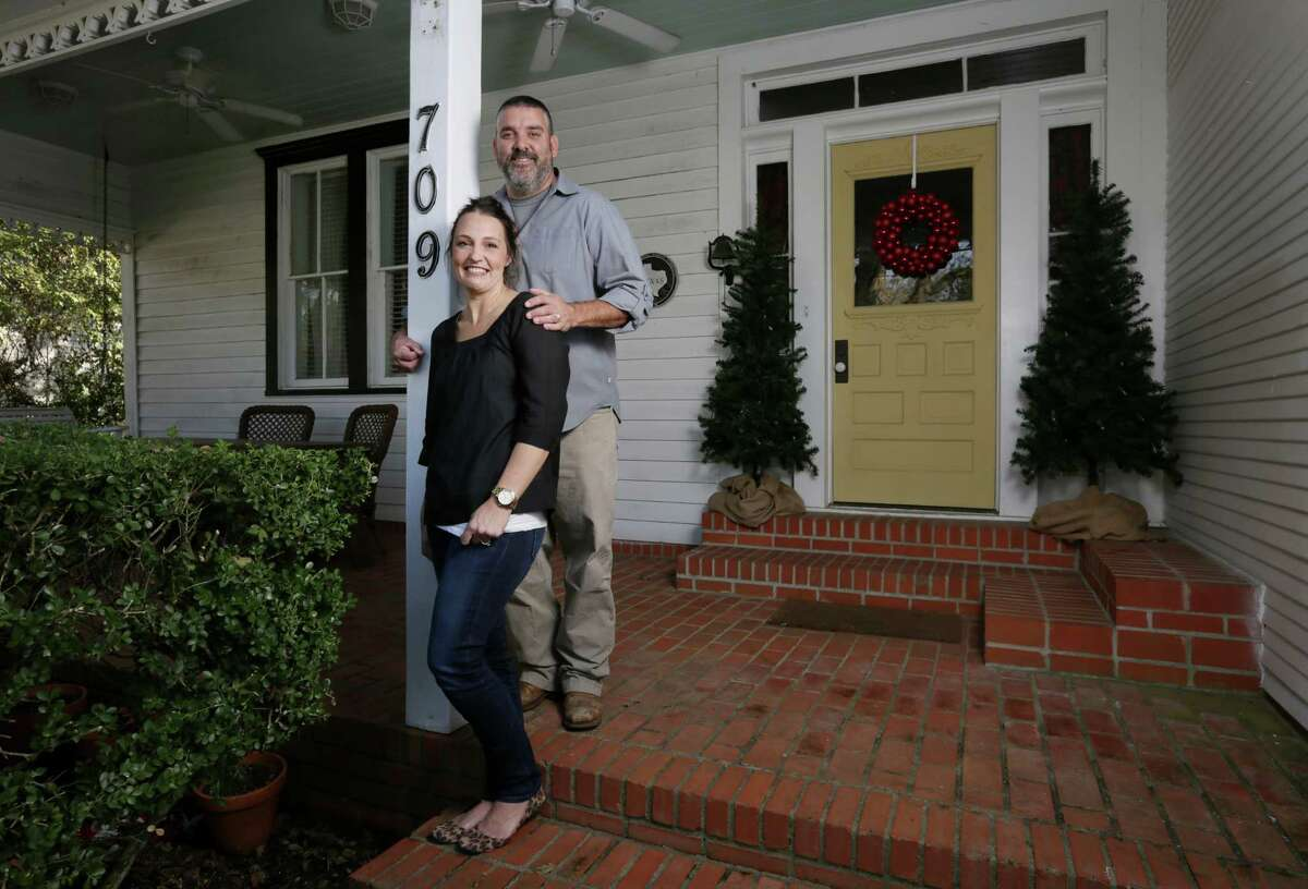 Julie and Tommy Hauser pose for a portrait at their home.
