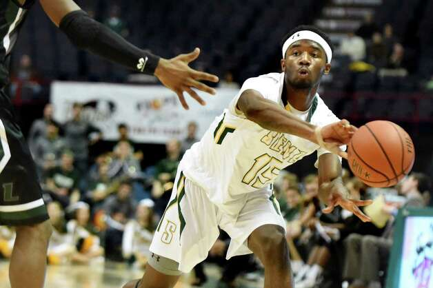 Siena's Nico Clareth passes the ball during their basketball game against Loyola on Saturday, Nov. 28, 2015, at Times Union Center in Albany, N.Y. (Cindy Schultz / Times Union) Photo: Cindy Schultz / 10034443A