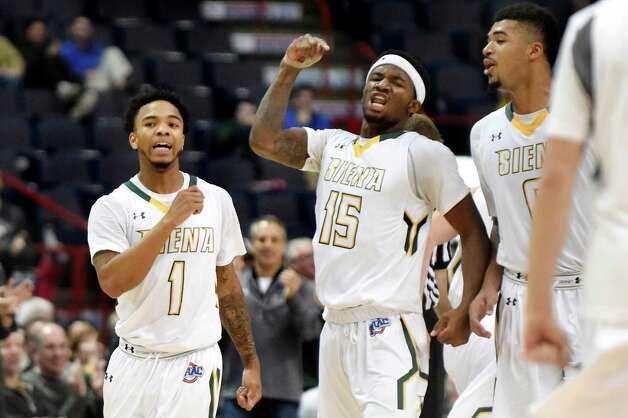 Siena's Marquis Wright, left, Nico Clareth, center, and Javion Ogunyemi celebrate a call during their basketball game against Loyola on Saturday, Nov. 28, 2015, at Times Union Center in Albany, N.Y. (Cindy Schultz / Times Union) Photo: Cindy Schultz / 10034443A