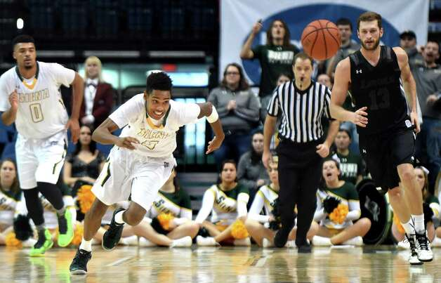 Siena's Kenny Wormley, second from left, chases down a loose ball during their basketball game against Loyola on Saturday, Nov. 28, 2015, at Times Union Center in Albany, N.Y. (Cindy Schultz / Times Union) Photo: Cindy Schultz / 10034443A