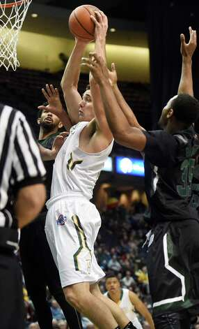 Siena's Brett Lisping, center, goes to the hoop during their basketball game against Loyola on Saturday, Nov. 28, 2015, at Times Union Center in Albany, N.Y. (Cindy Schultz / Times Union) Photo: Cindy Schultz / 10034443A