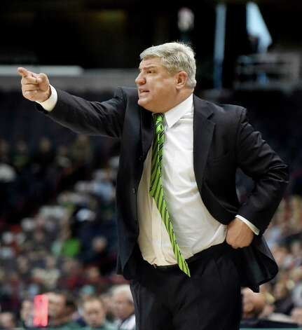 Siena's coach Jimmy Patsos instructs his team during their basketball game against Loyola on Saturday, Nov. 28, 2015, at Times Union Center in Albany, N.Y. (Cindy Schultz / Times Union) Photo: Cindy Schultz / 10034443A