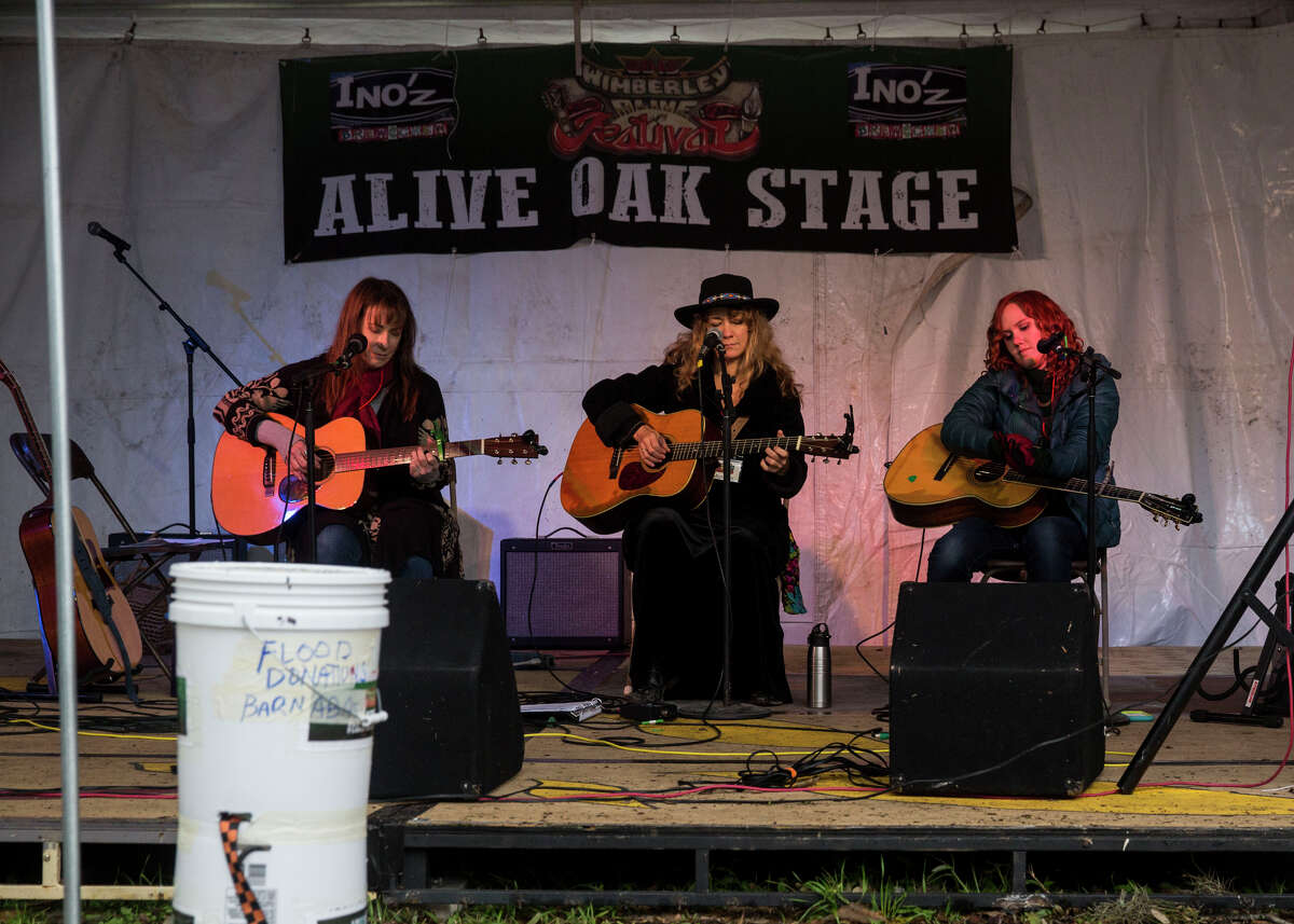 Karen Mal, Grace Pettis and Kim Miller perform during the Wimberley Alive event in Wimberley, Texas on November 28, 2015. The event is a fundraiser for victims of the Memorial Day floods along the Blanco River.