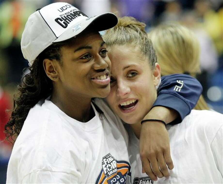 Connecticut's Tiffany Hayes, left, hugs Caroline Doty after Connecticut won the NCAA Dayton Regional final college basketball game 90-50 over Florida State Tuesday, March 30, 2010, in Dayton, Ohio. Connecticut advances to the Women's Final Four in San Antonio. (AP Photo/Skip Peterson)