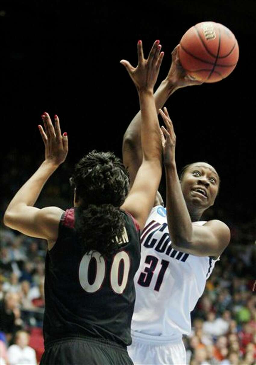 Connecticut's Tina Charles (31) shoots over Florida State's Chasity Clayton (00) in the first half of the NCAA Dayton Regional final college basketball game Tuesday, March 30, 2010, in Dayton, Ohio. (AP Photo/Skip Peterson)