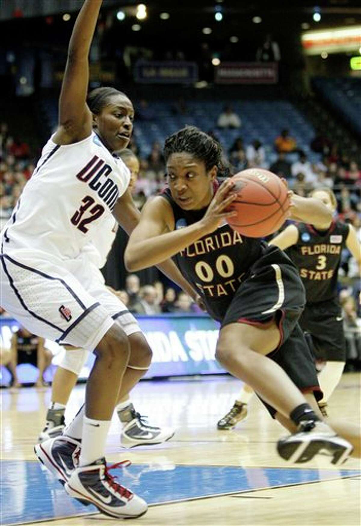 Florida State's Chasity Clayton (00) drives on Kalana Greene (32) in the first half of the NCAA Dayton Regional final college basketball game Tuesday, March 30, 2010, in Dayton, Ohio. (AP Photo/Al Behrman)