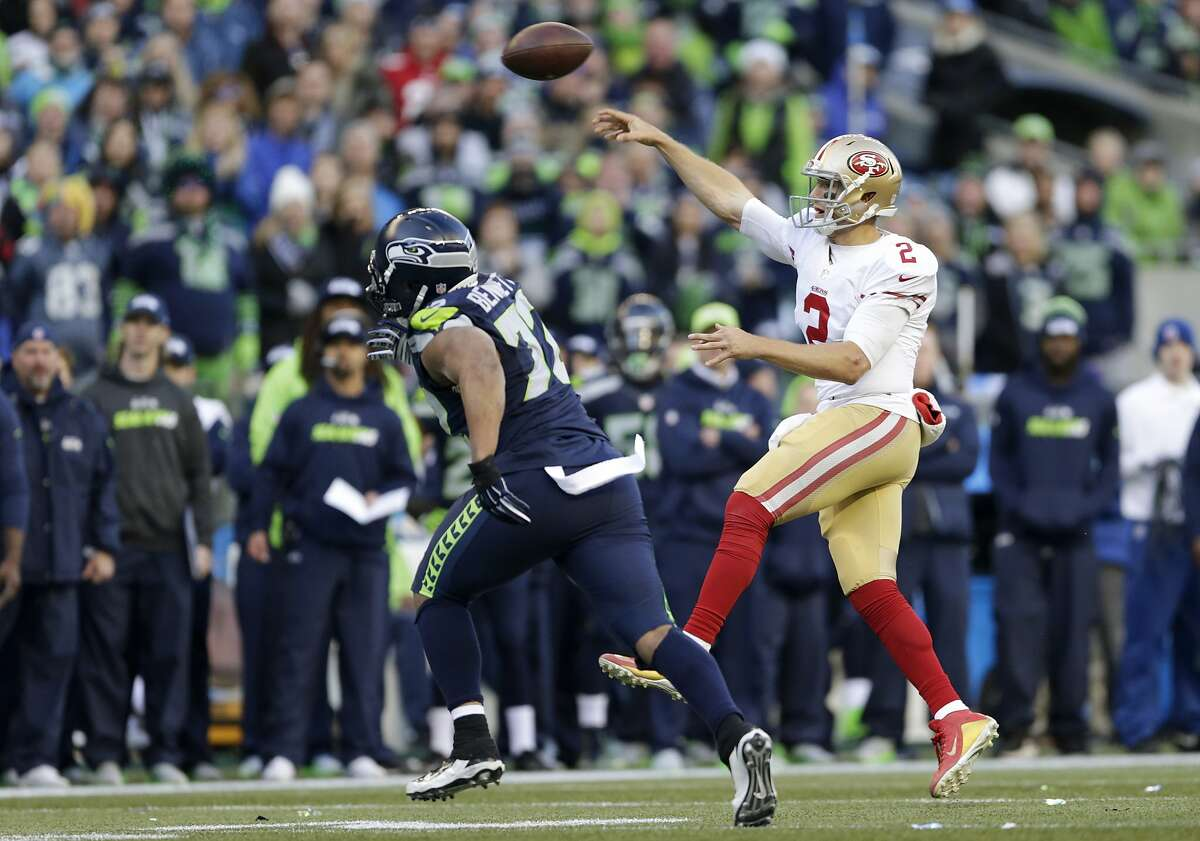 San Francisco 49ers quarterback Blaine Gabbert, right, gets a pass off against the Seattle Seahawks in the second half of an NFL football game, Sunday, Nov. 22, 2015, in Seattle. (AP Photo/John Froschauer)