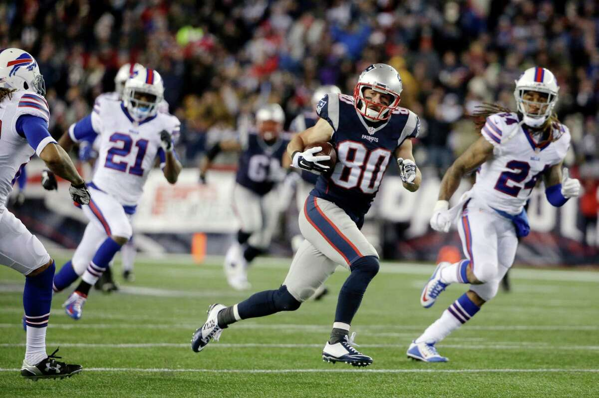 New England Patriots wide receiver Danny Amendola (80) runs after catching a pass in the second half of an NFL football game against the Buffalo Bills, Monday, Nov. 23, 2015, in Foxborough, Mass. (AP Photo/Steven Senne) ORG XMIT: FBO131