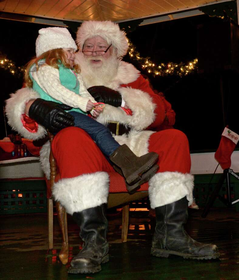 Jolee Glynn, 3, of New Milford, visits with Santa during the Festival of Lights on the village green, in New Milford, on Saturday, night, November 28, 2015, in New Milford, Conn. Photo: H John Voorhees III, Hearst Connecticut Media / The News-Times
