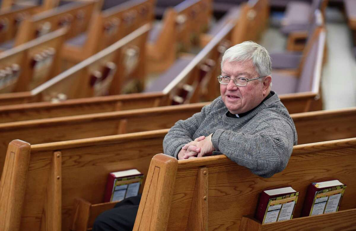 Father Kenneth Doyle sits in the pews of the Mater Christi Parish Church Thursday morning Nov. 19, 2015 in Albany, N.Y. (Skip Dickstein/Times Union)