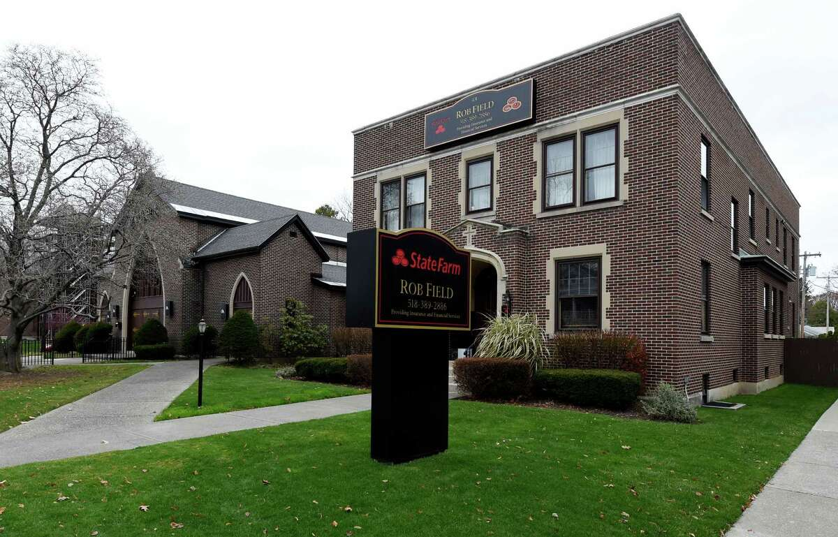 State Farm Insurance has taken over the former St. Teresa of Avilia rectory after the consolidation of parishes Thursday morning Nov. 19, 2015 in Albany, N.Y. (Skip Dickstein/Times Union)