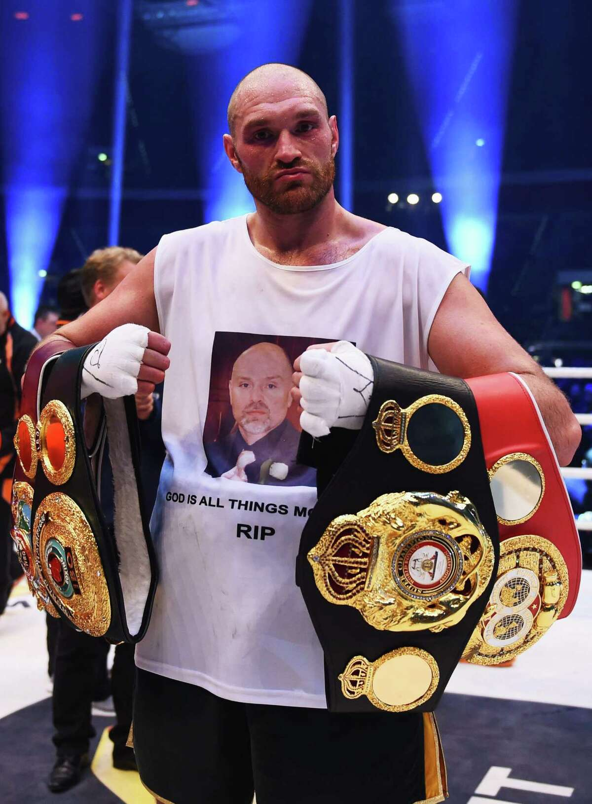 DUESSELDORF, GERMANY - NOVEMBER 28: Tyson Fury celebrates with title belts as he defeats Wladimir Klitschko to become new World Heavyweight Champion after the IBF IBO WBA WBO Heavyweight World Championship contest at Esprit-Arena on November 28, 2015 in Duesseldorf, Germany. (Photo by Lars Baron/Bongarts/Getty Images) ORG XMIT: 592603167