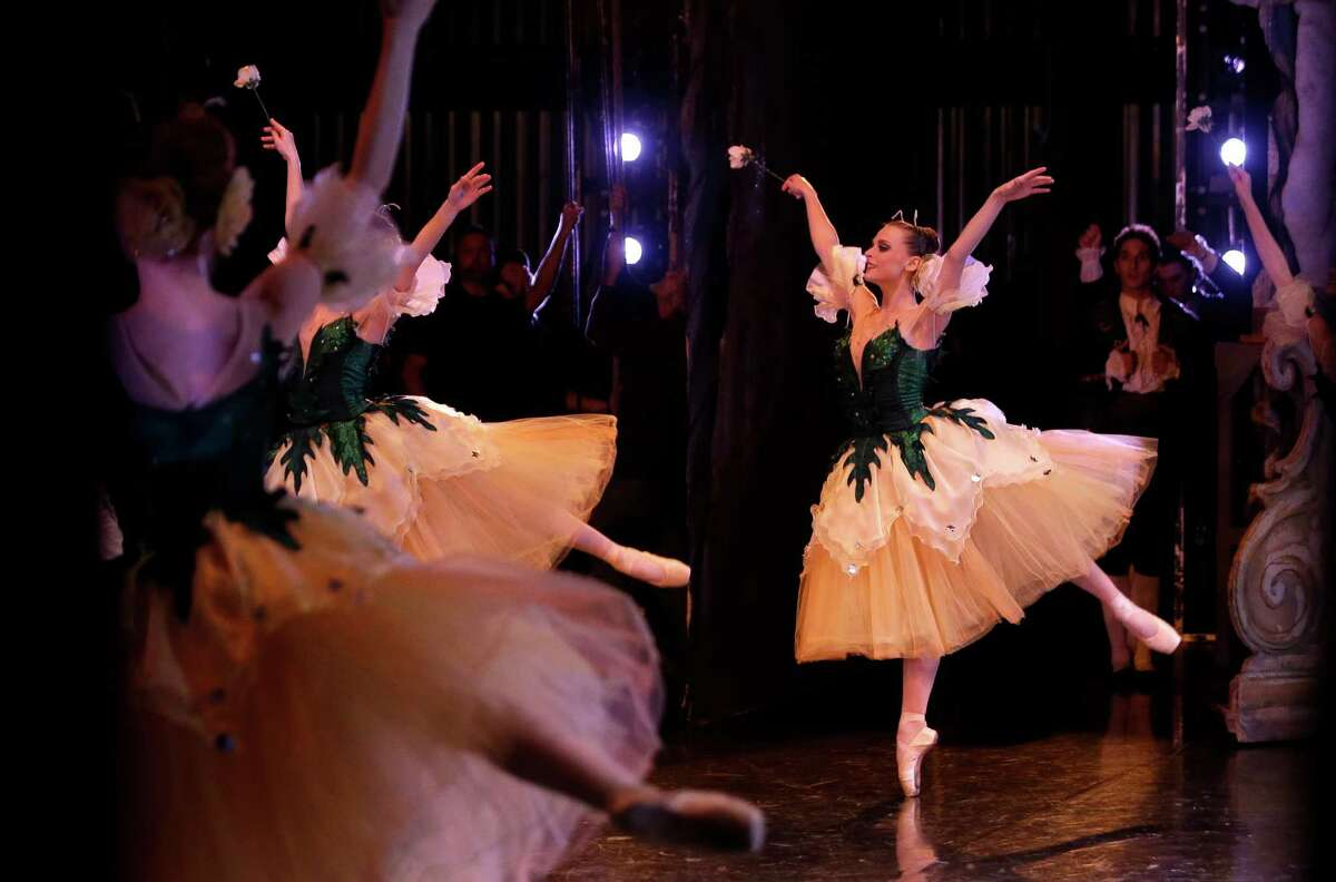 """Shown from the wings backstage, members of the Houston Ballet perform a dress rehearsal of """"The Nutcracker"""" at the Wortham Theater Center Tuesday, Nov. 24, 2015, in Houston. This is the last year the Houston Ballet will perform Ben Stevenson's version of """"The Nutcracker,"""" which has a Houston holiday staple for 28 years."""