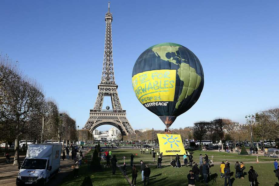 Greenpeace anchors a hot-air balloon next to the Eiffel Tower to tout the use of alternative energy as world leaders gather for climate talks in Paris. Photo: Micha Patault, AFP / Getty Images