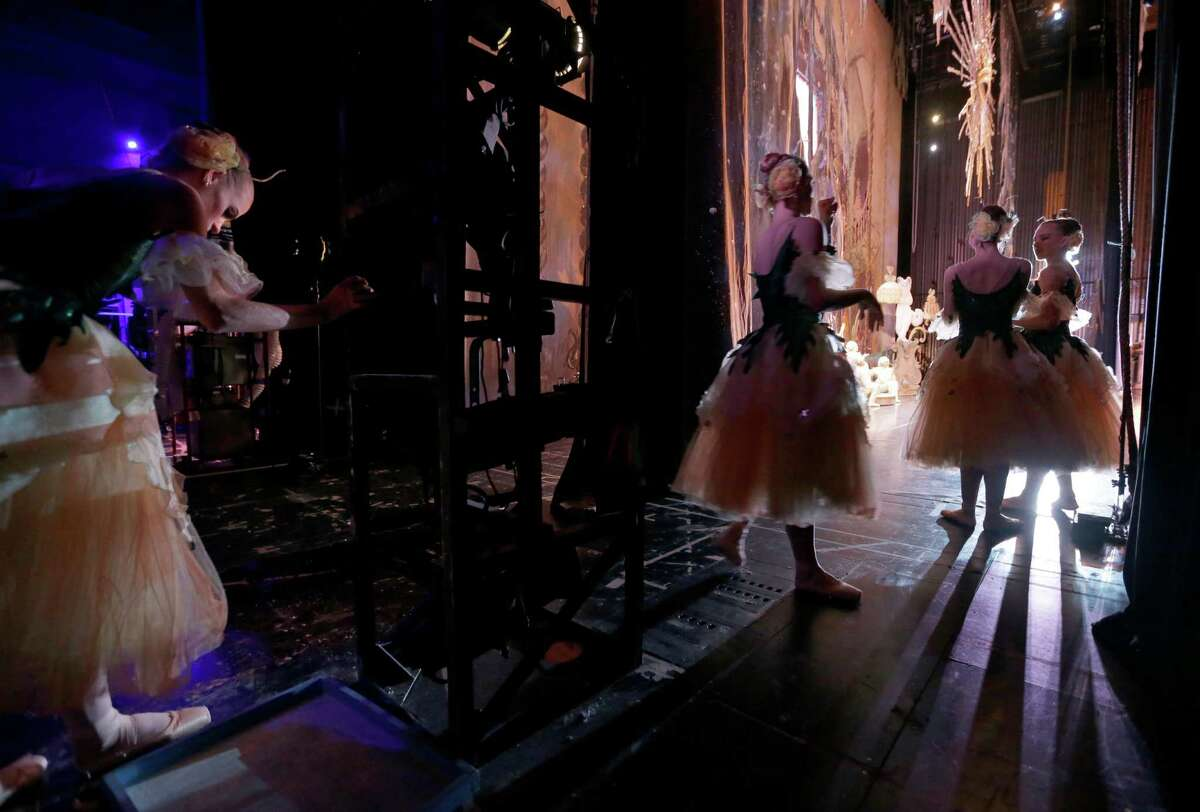 """A balleria steps into a rosin box backstage as she and other members of the Houston Ballet perform a dress rehearsal of """"The Nutcracker"""" at the Wortham Theater Center Tuesday, Nov. 24, 2015, in Houston. This is the last year the Houston Ballet will perform Ben Stevenson's version of """"The Nutcracker,"""" which has a Houston holiday staple for 28 years."""