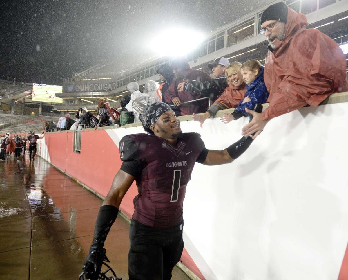 George Ranch 48, Bryan 28 George Ranch Longhorns running back Darius Anderson (1) greets fans after the Class 5A Division I region semifinals at TDECU stadium Saturday, Nov. 28, 2015. ( Jon Shapley / Houston Chronicle )