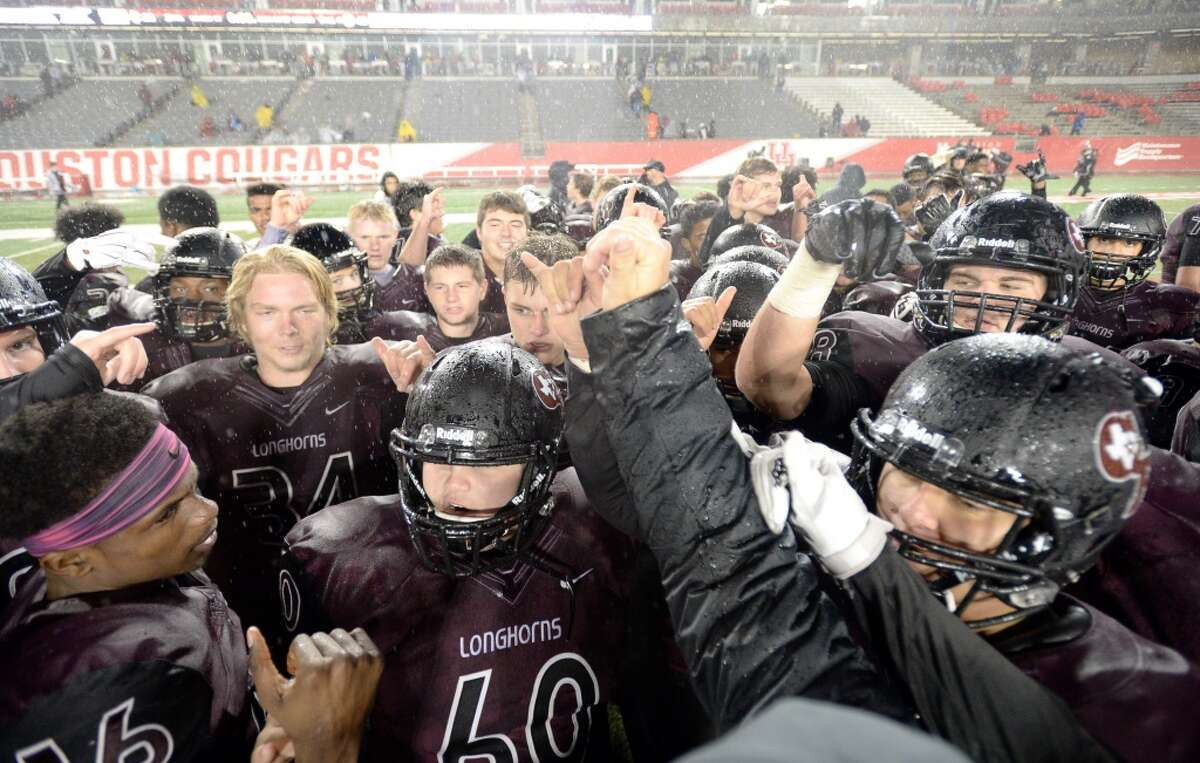 The George Ranch Longhorns celebrate after winning the Class 5A Division I region semifinals at TDECU stadium Saturday, Nov. 28, 2015. ( Jon Shapley / Houston Chronicle )