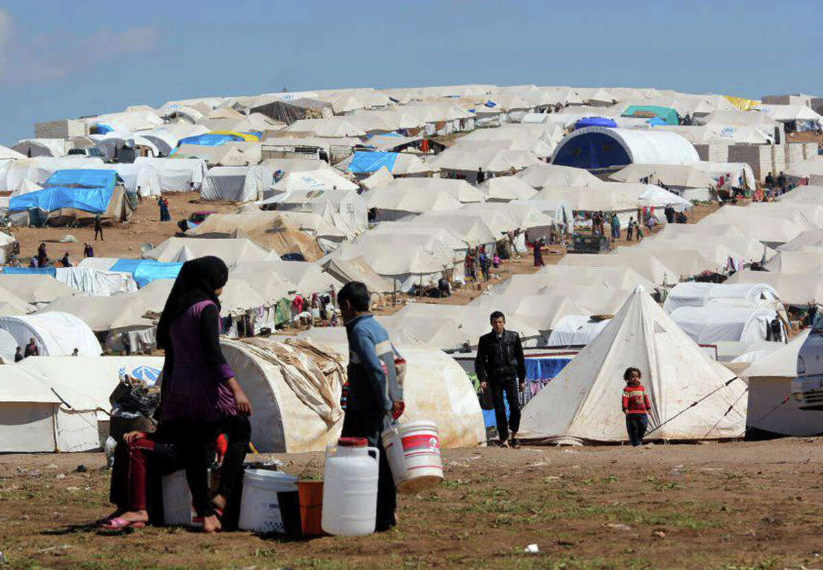 1. Texas takes in more refugees than any other state - about 10 percent of the total refugees placed in the United States. In October, the state received 584 refugees, including 21 from Syria. Refugees fill their buckets at Atmeh refugee camp, nicknamed Olive Tree.