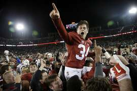 Stanford place kicker Conrad Ukropina (34) is lifted by fans and teammates after hitting a 45-yard field goal as time expired to give Stanford a 38-36 win over Notre Dame in an NCAA college football game Saturday, Nov. 28, 2015, in Stanford, Calif. (AP Photo/Marcio Jose Sanchez)