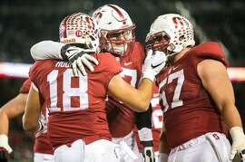 Stanford tight end, Austin Hooper (18) celebrates with teammates after scoring a touchdown in the Stanford vs. Notre Dame game at the Stanford Stadium on Saturday, Nov. 28, 2015 in Palo Alto, Calif.